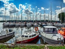 Marina in Sztynort in northern in Poland. Marina in Sztynort over Sztynorckie lake in Masuria region in northern Poland. Tens of modern yachts, sailboats and royalty free stock photos