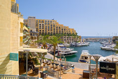 Marina and terrace of Hilton hotel, Malta. Portomaso Marina, almost full of yachts, is surrounded by buildings of Hilton Malta Hotel, which located in the city Royalty Free Stock Image