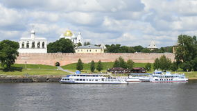 Marina tourist ships on the Volkhov river against the background of the Kremlin of Veliky Novgorod. Russia stock video footage