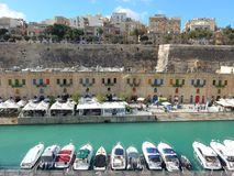 The marina of Valletta, Malta. Motorboats in front and the city of Valletta and the hill in the back Stock Photography