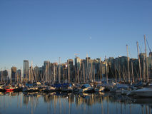 Marina & Vancouver Downtown. Boats reflections in a marina next to Downtown Vancouver Royalty Free Stock Image