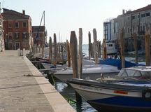 MARINA IN VENICE. ITALY. EVENING SUN, MODERN MOTOR BOATS, OLD BUILDINGS Royalty Free Stock Photography