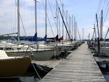 Marina view 2. View at the marina: deck and yachts. Early summer Royalty Free Stock Photos
