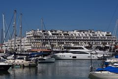 Marina Vilamoura , Algarve, Portugal, Europe. Luxury Yachts and motor boats moored at the marina of Vilamoura with buildings and blue sky in background royalty free stock photography