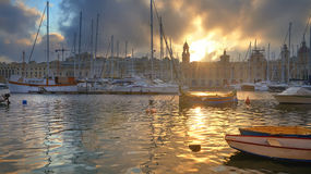 Marina in Vittoriosa, Grand Valletta Bay, Malta on a sunrise. Marina in Vittoriosa, one of the Three Cities across Valletta Bay, Malta. Sunrise through the Stock Images