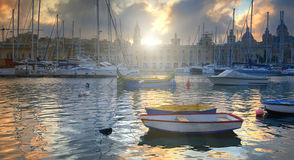 Marina in Vittoriosa, Grand Valletta Bay, Malta on a sunrise. Marina in Vittoriosa, one of the Three Cities across Valletta Bay, Malta. Sunrise through the Royalty Free Stock Image