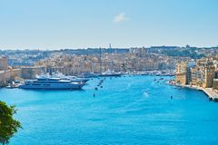 Marina of Vittoriosa, Malta. The ramparts of Valletta open the great view on medieval city of Birgu Vittoriosa with marina, full of luxury yachts and boats Royalty Free Stock Photos
