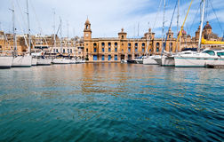 Marina in Vittoriosa, Valetta, Malta. Marina in Vittoriosa, one of the Three Cities across Valetta Bay, Malta; the building with the clock is Maritime Museum Stock Photos