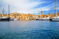 Marina in Vittoriosa, Valletta Bay, Malta. Marina in Vittoriosa, one of the Three Cities across Valetta Bay, Malta; the building with the clock is Maritime Royalty Free Stock Image