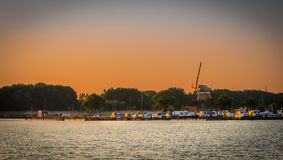 Marina and windmill on the sunset Stock Photography