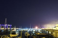 Marina, yacht port in summer night royalty free stock images