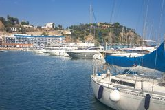 Marina with yachts in Blanes, Costa Brava, Spain. Sail boats in sea port. Sailboat harbor, many beautiful moored sail yachts. In the sea port royalty free stock photo