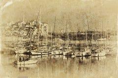 Marina with yachts. Old style photo Royalty Free Stock Image