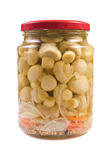 Marinaded mushrooms in a glass jar . Stock Photos