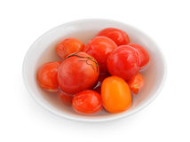 Marinaded tomatoes in a white plate. Stock Photo