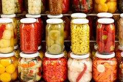 Marinaded vegetables in cans Stock Image
