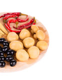 Marinaded vegetables on wooden platter. Royalty Free Stock Photos