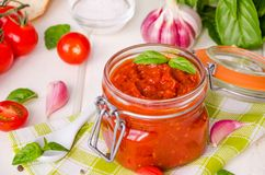 Marinara sauce. Traditional Italian tomato sauce with herbs, olive oil and garlic. In a glass jar stock photo