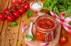 Marinara sauce. Traditional Italian tomato sauce with herbs, olive oil and garlic. In a glass jar royalty free stock images