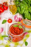 Marinara sauce. Traditional Italian tomato sauce with herbs, olive oil and garlic. In a glass jar royalty free stock photos