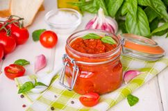 Marinara sauce. Traditional Italian tomato sauce with herbs, olive oil and garlic. In a glass jar stock photography