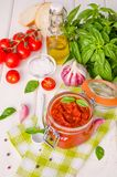 Marinara sauce. Traditional Italian tomato sauce with herbs, olive oil and garlic. In a glass jar stock images