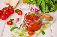 Marinara sauce. Traditional Italian tomato sauce with herbs, olive oil and garlic. In a glass jar royalty free stock photo