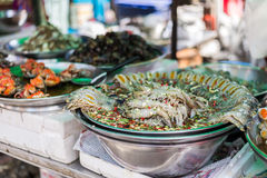 Marinate raw food. Marinate raw mantis shimps for sell in area of Yaowarat or Chinatown of Thailand Royalty Free Stock Photo