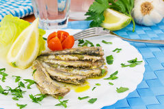 Marinated anchovies in the dish with lemon Royalty Free Stock Images