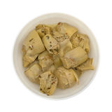 Marinated artichoke hearts in bowl top view Royalty Free Stock Photo