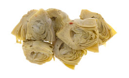 Marinated artichoke hearts on a white background Stock Image