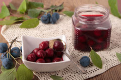 Marinated berries of blackthorn in square bowl Stock Photo