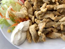 Marinated breaded and fried boquerones with salad and mayonnaise stock image
