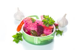 Marinated cabbage with beets. And other vegetables on a white background stock image
