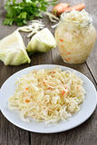 Marinated cabbage. On country table royalty free stock image