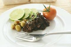 Marinated calamari salad and serviette Stock Images