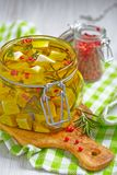 Marinated cheese in olive oil Royalty Free Stock Photos