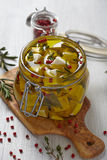 Marinated cheese in olive oil Royalty Free Stock Photography