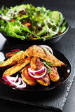Marinated chicken breast stripes with salad Royalty Free Stock Image
