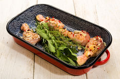 Marinated chicken drumstick in a roasting tin Stock Photos