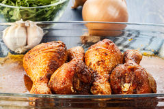 Marinated chicken drumsticks Stock Photos