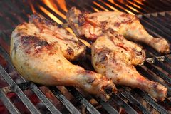 Marinated Chicken Legs Fried On The Hot Flaming BBQ Grill Royalty Free Stock Photo
