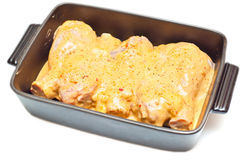 Marinated chicken legs in a tray Stock Photos