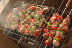 Marinated chicken steaks on a grill Stock Photos