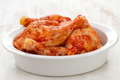 Marinated chicken in white dish Stock Photos