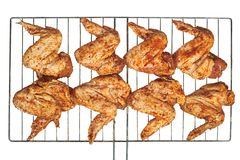 Marinated chicken wings prepared for grill. Chicken wings on the grill isolated on white background Stock Images