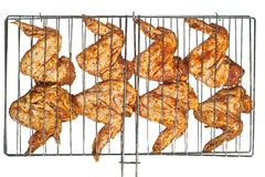 Marinated chicken wings prepared for grill. Chicken wings on the grill isolated on white background Stock Photography