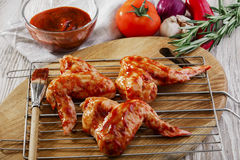 Marinated chicken wings raw. Red Royalty Free Stock Photo