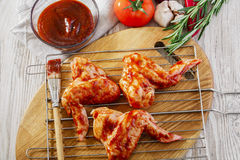 Marinated chicken wings raw. Red Stock Photo