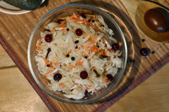 Marinated cranberries in cabbage Stock Images